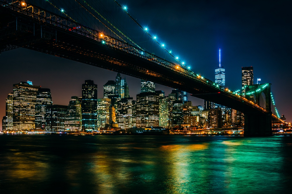 The Brooklyn Bridge and Manhattan Skyline at night seen from Brooklyn Bridge Park, New York..jpeg